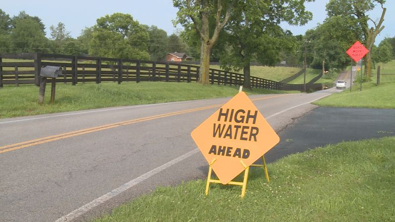 A 'High Water Ahead' sign indicated water over Ironworks Road in Scott County.