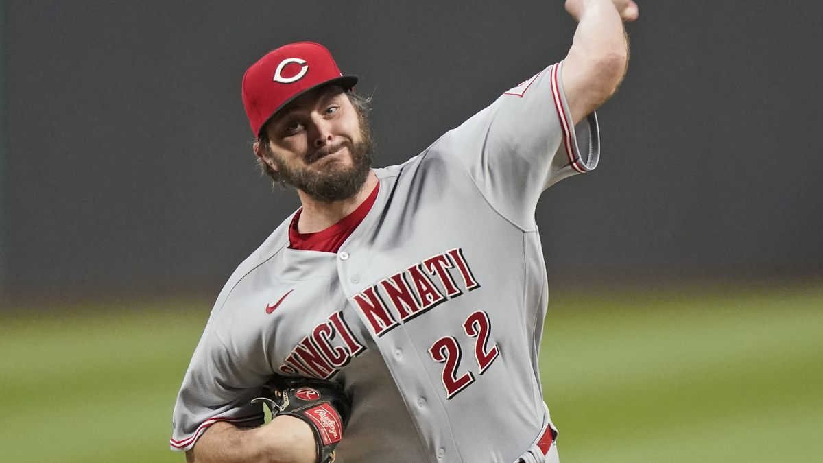 Cincinnati Reds starting pitcher Wade Miley delivers in the first inning of a baseball game...