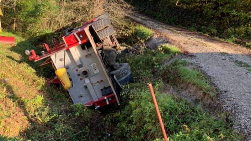 Sandy Hook Fire Department pumper truck rolls into ditch.