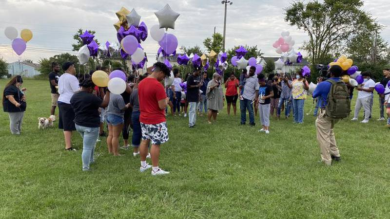 During an emotional vigil, friends and family leaned on each other as they cope with the loss...