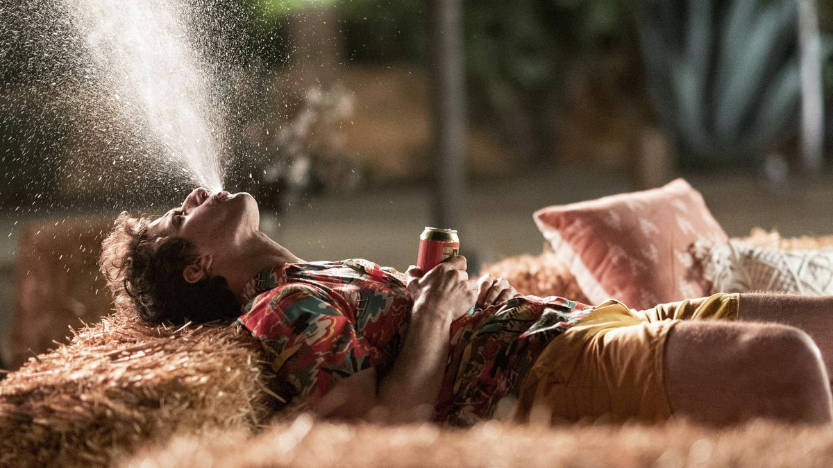 """This image released by Hulu shows Andy Samberg in a scene from the film """"Palm Springs."""" (Christopher Willard/Hulu via AP)"""