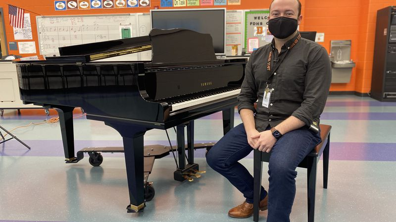 Choir director Jordan Lindsey is changing the way he conducts class during the pandemic.