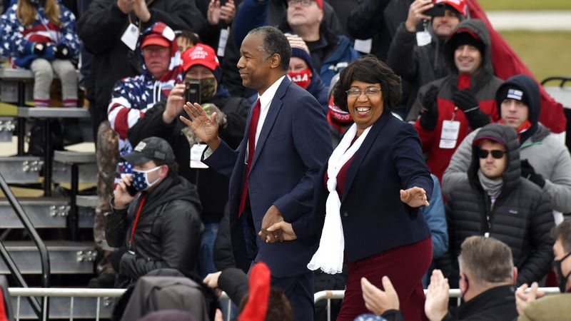 Housing and Urban Development Secretary Ben Carson, left, and his wife, Candy Carson, walk on...