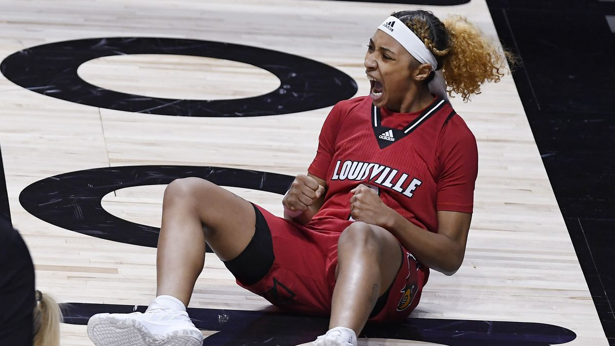 Louisville's Ahlana Smith reacts after being fouled while making a basket during the first half...