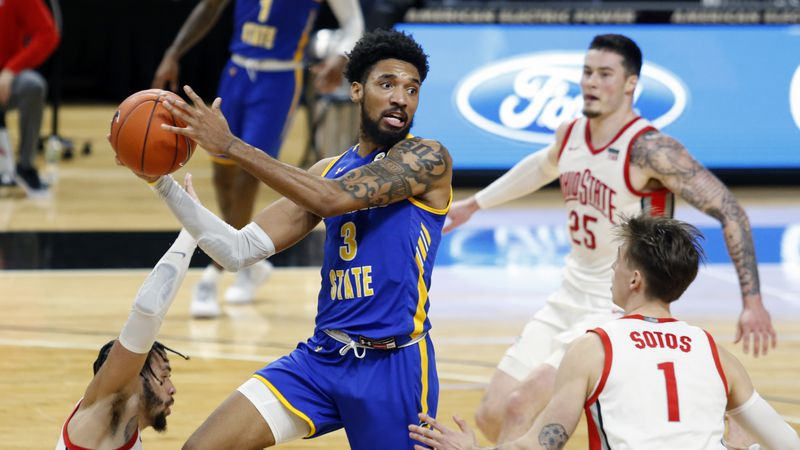Morehead State forward James Baker (3) looks to pass between Ohio State guard Duane Washington...