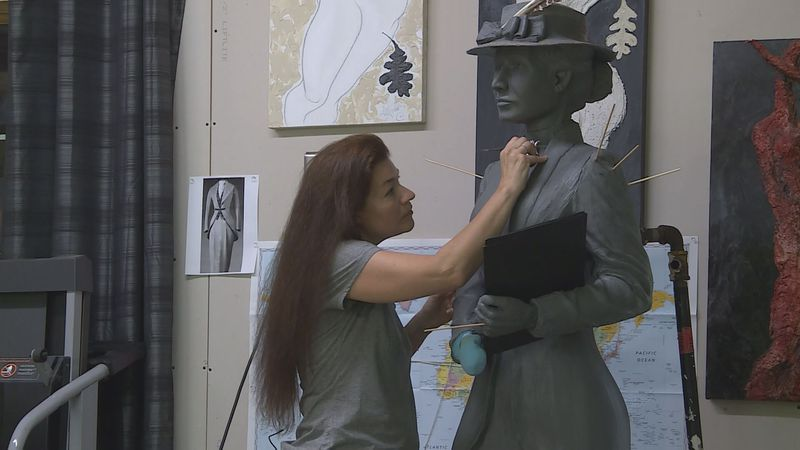 Amanda Matthews works on the statue of Nettie Depp in her Lexington studio.