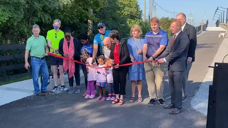The ribbon was cut Monday to officially open the new Brighton Rail Trail bridge over Man O' War...