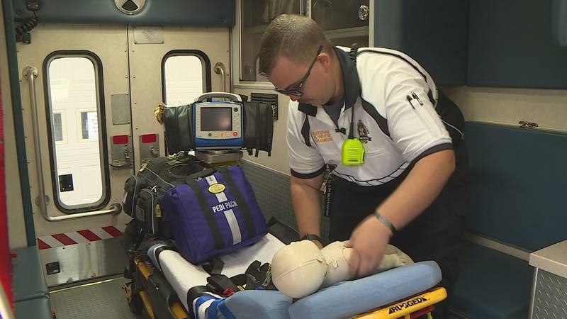 Jessamine County's pediatric emergency care coordinator unpacks some equipment the EMS agency...