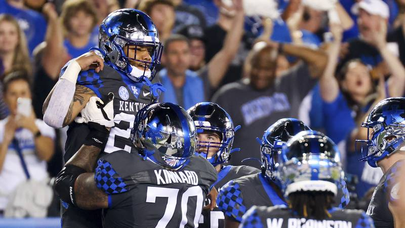 Kentucky running back Chris Rodriguez Jr., left, celebrates his touchdown during the first half...
