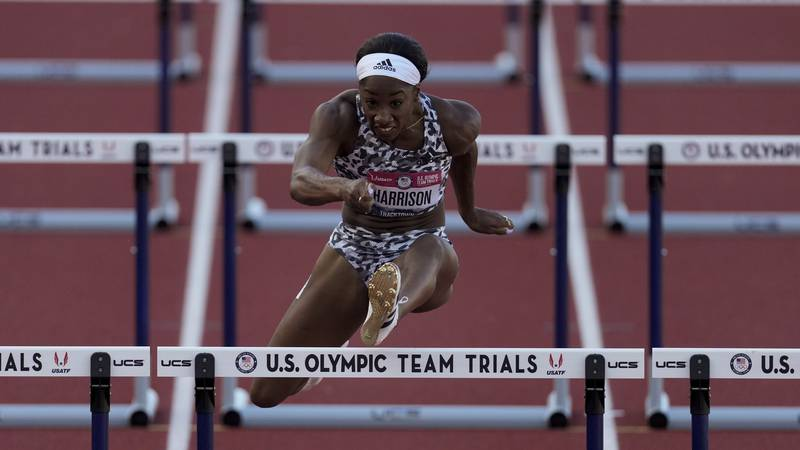 Keni Harrison wins the the second semi-final in the women's 100-meter hurdles at the U.S....