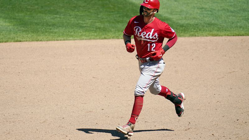 Cincinnati Reds' Tyler Naquin (12) rounds the bases on a three-run home run off Minnesota...