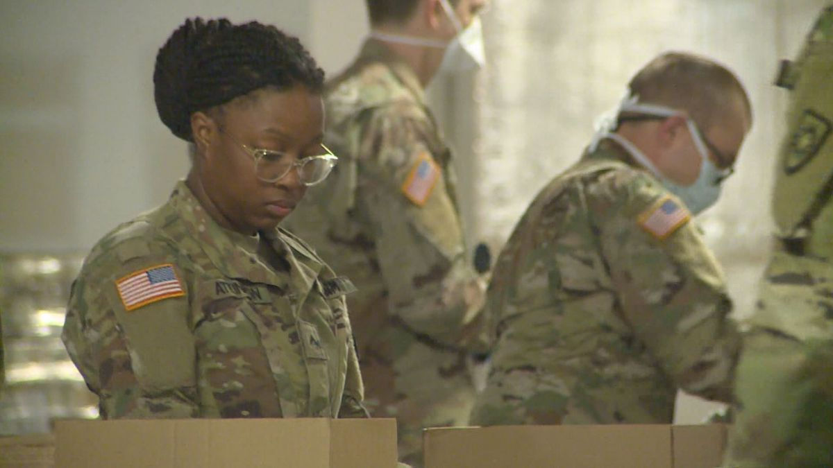 A Kentucky National Guard member unpacks a box of supplies in the midst of the state's COVID-19 outbreak. (Photo: WKYT/Victor Puente)