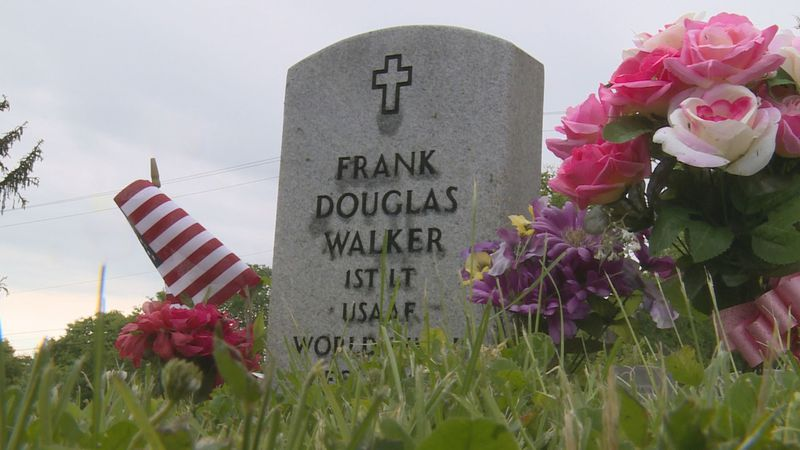 A flag is placed by Frank Douglas Walker's grave, a Tuskegee Airmen.