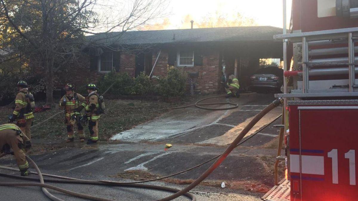 Crews battle a house fire on Pine Meadow Road in Lexington. (WKYT)