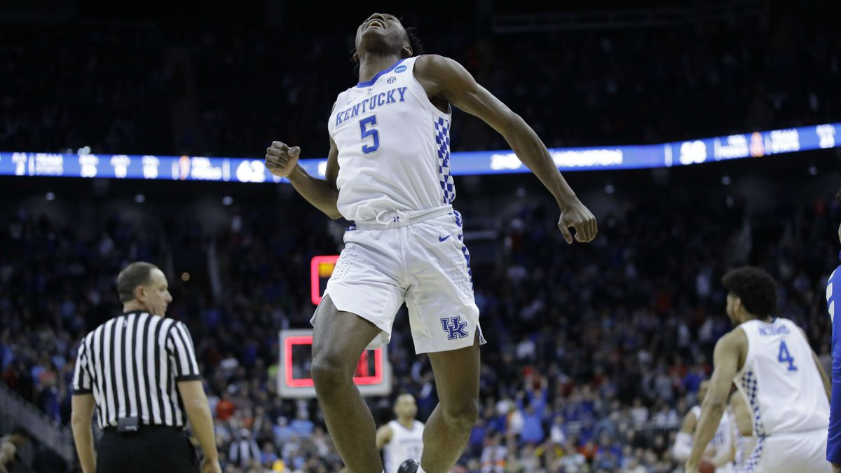 Kentucky's Immanuel Quickley celebrates as time expires in a men's NCAA tournament college basketball Midwest Regional semifinal game against Houston Friday, March 29, 2019, in Kansas City, Mo. (AP Photo/Charlie Riedel)