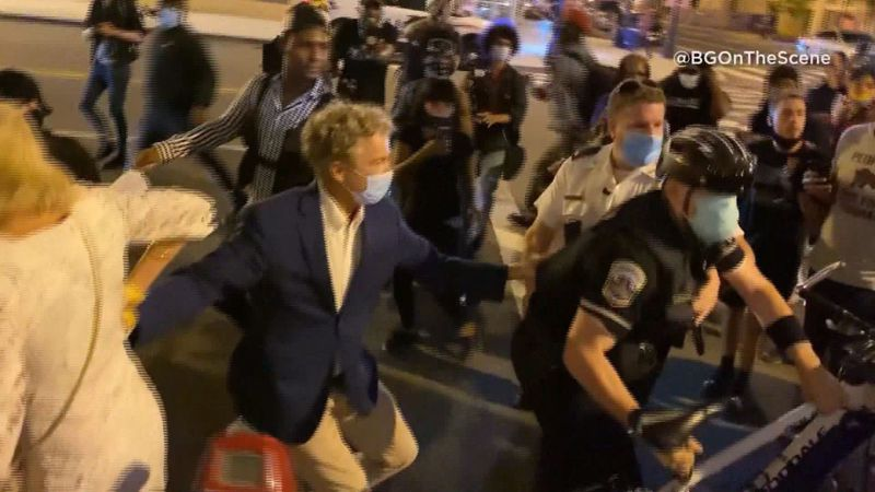 Senator Paul and his wife were escorted through protesters to their hotel.