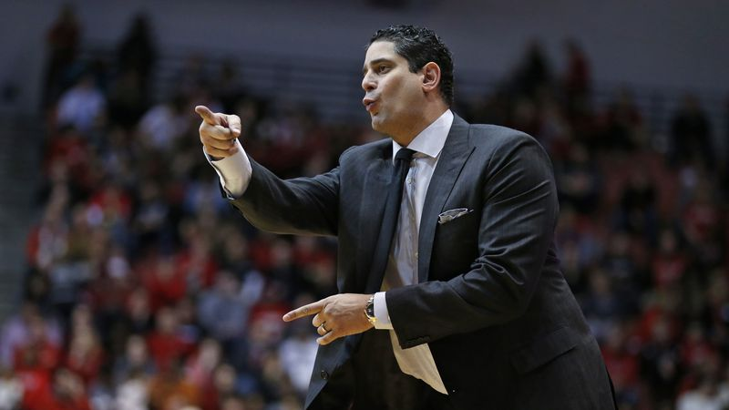 South Florida head coach Orlando Antigua directs his team during the second half of an NCAA...