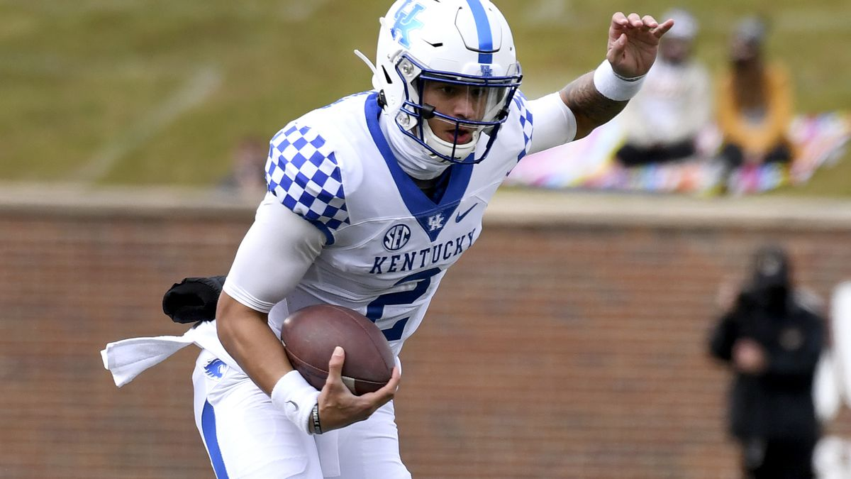 Kentucky quarterback Joey Gatewood runs with the ball during the first half of an NCAA college...