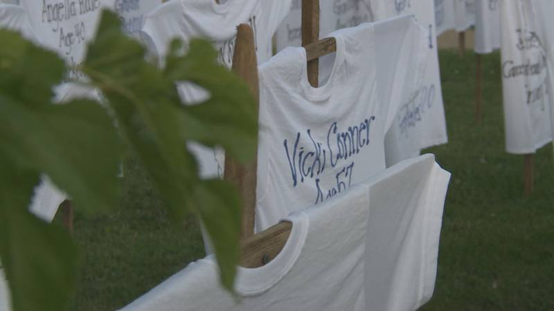 Each shirt listed a victim's name, age, hometown, cause of death, and the month they died.
