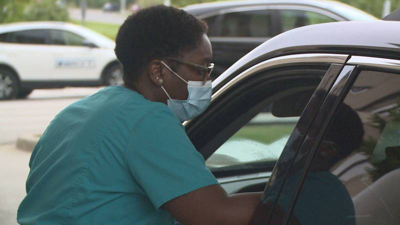 Monday morning, a drive-through testing site started seeing patients at Baptist Health in...
