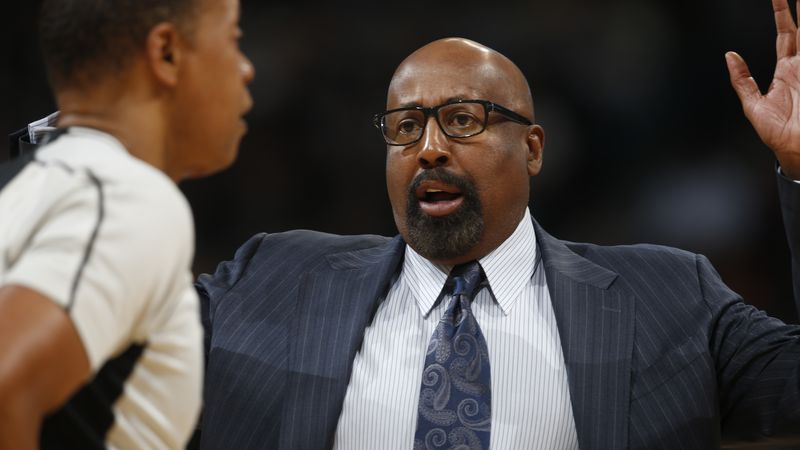 Los Angeles Clippers assistant coach Mike Woodson makes a point while facing the Denver Nuggets...