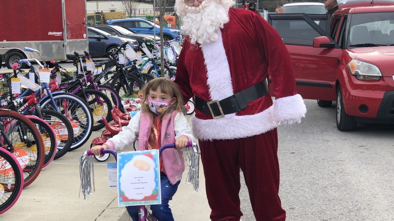The drive-thru event featured a visit from Santa as well as other surprises for area families.