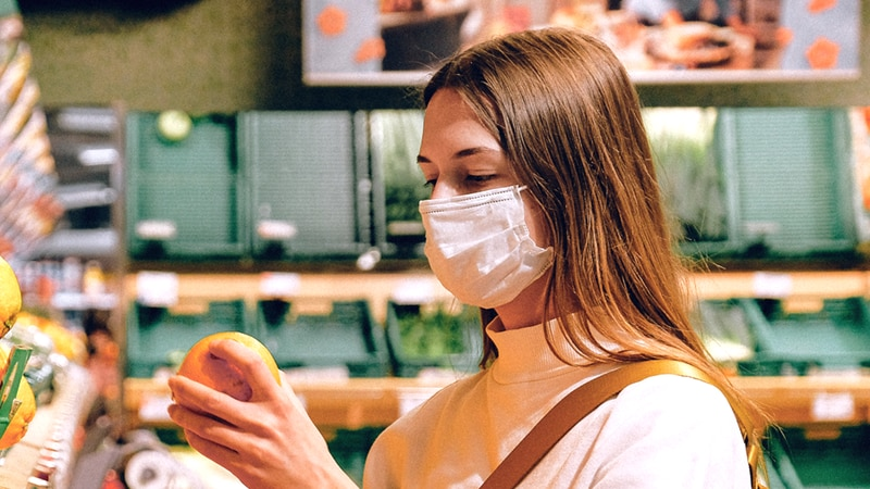 The CDC relaxed its guidance in April on wearing masks outdoors but still advises both...