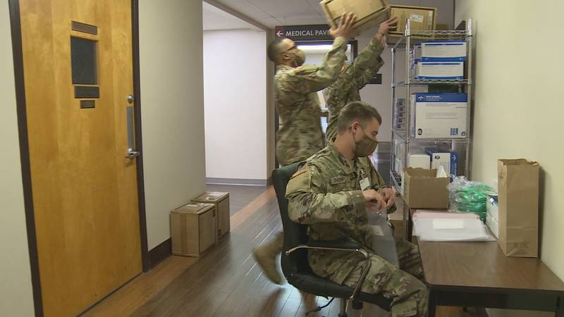 A team of 15 National Guard members help restock supplies.