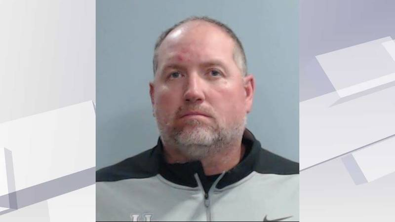 UK football Chief of Staff Dan Berezowitz was arrested and charged with fourth degree assault.