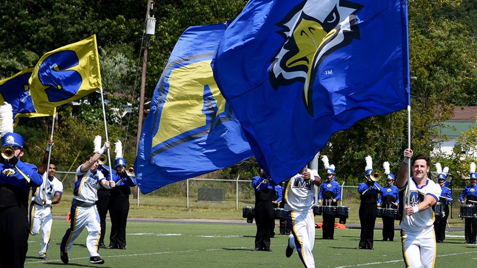 Morehead State University Color Guard running onto the field.