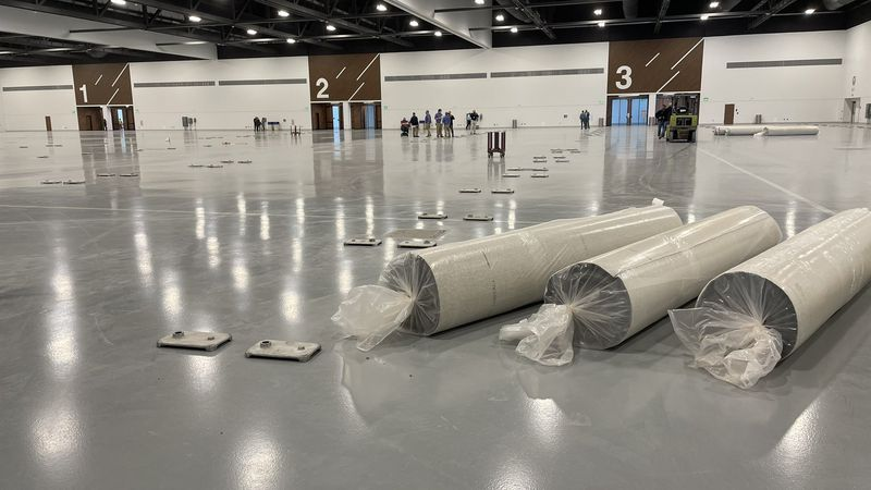 Standing in the recently completed 103,000 square foot Exhibit Hall, phase one of the Central...