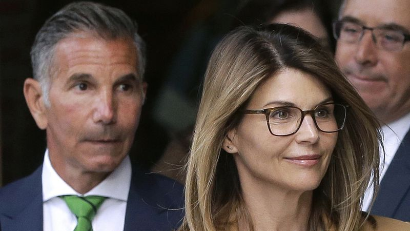 In this April 3, 2019 file photo, actress Lori Loughlin, front, and husband, clothing designer...