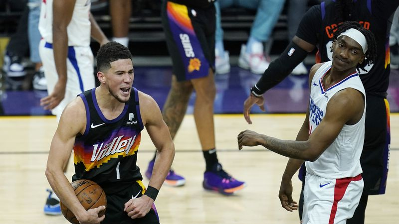 Phoenix Suns guard Devin Booker (1) celebrates near the end of the second half of Game 1 of the...