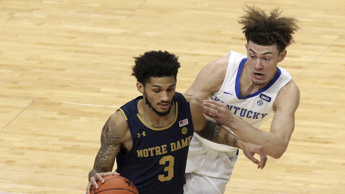Notre Dame's Prentiss Hubb (3) drives near Kentucky's Devin Askew during the first half of an...