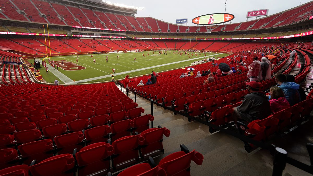 FILE - In this Aug. 29, 2020, file photo, fans watch the Kansas City Chiefs during NFL football training camp, at Arrowhead Stadium in Kansas City, Mo. A football-starved nation is getting its games back with the start of the NFL season, but many worry that attending games or get-togethers will lead to a new surge in coronavirus infections. NFL football will kick off Thursday, Sept. 10, in Kansas City at a stadium that's allowing 17,000 fans inside.