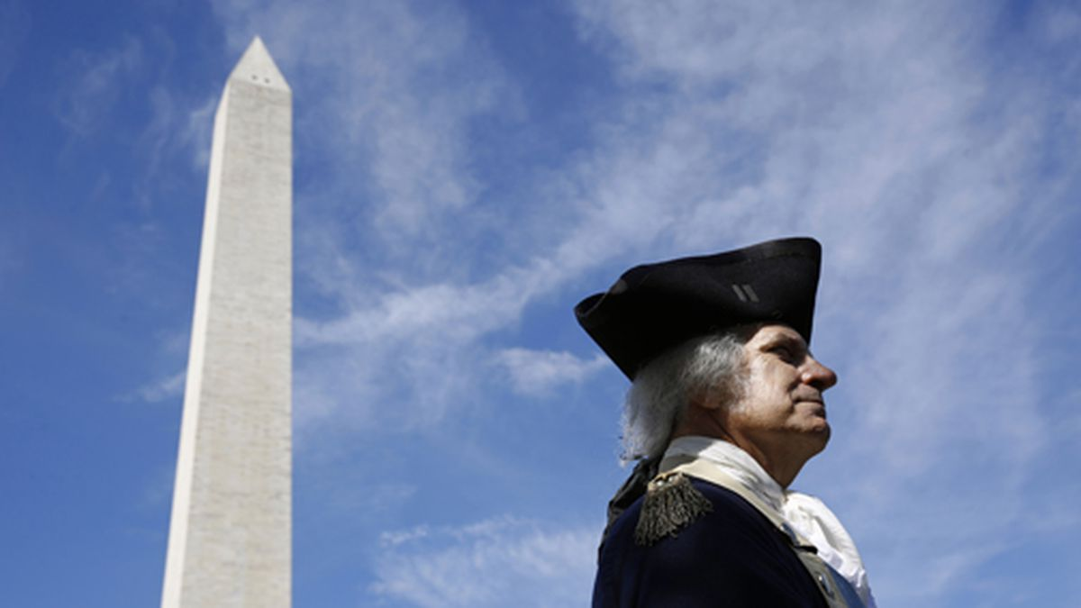 John Lopes, playing the part of President George Washington, stands near the Washington Monument following a ribbon-cutting ceremony with first lady Melania Trump to re-open the monument, Thursday, Sept. 19, 2019, in Washington. (AP Photo/Patrick Semansky)