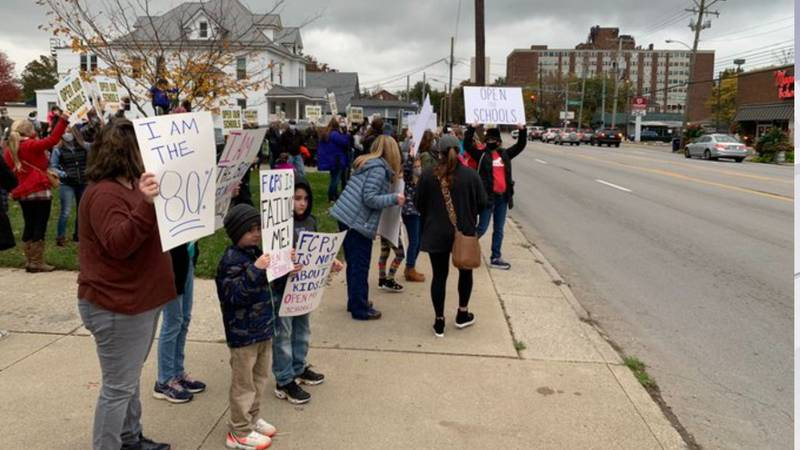 A group of parents and students are protesting outside of central office.