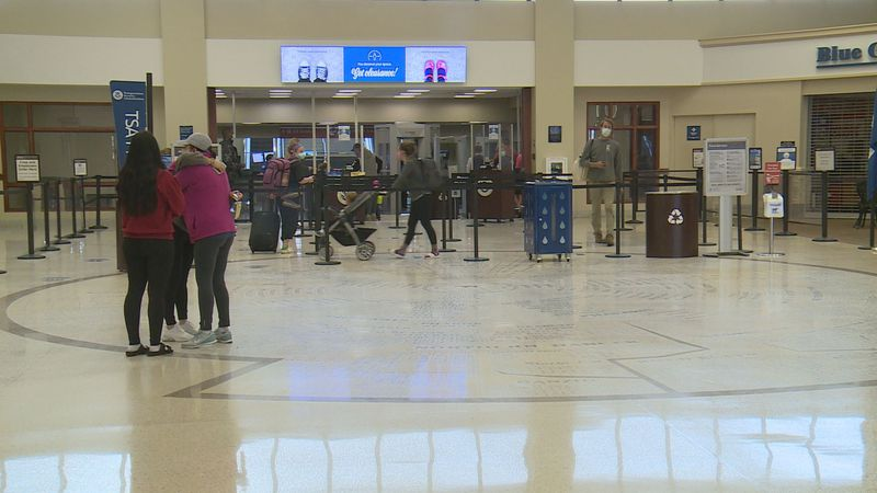 A family embraces each other in a hug at the Blue Grass Airport.