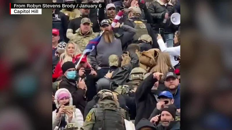Rioters in tactical gear are seen moving with purpose during the Capitol riot on Jan. 6.