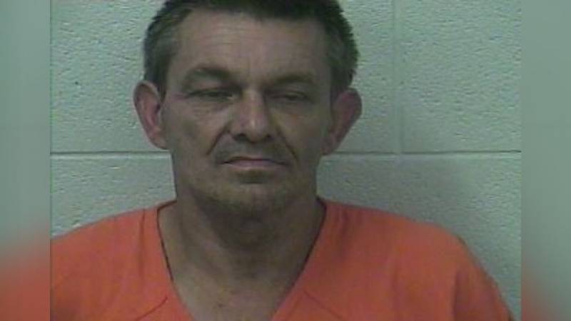 Police say they wanted to talk to Thomas Mitchell about his dogs killing his neighbor's chickens.