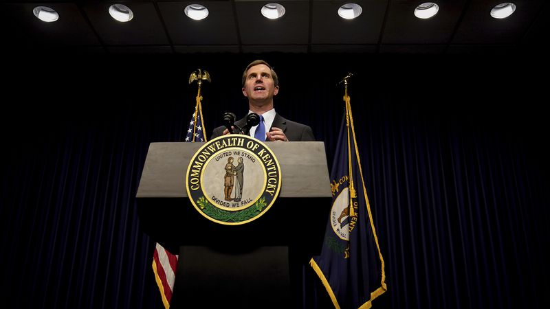 Kentucky Democratic Governor Andy Beshear speaks to the press at the Capitol in Frankfort, Ky.,...