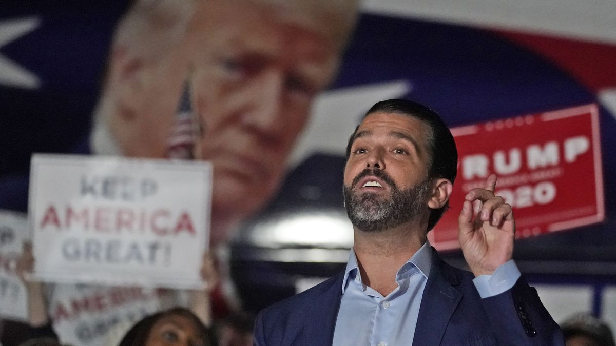 FILE - In this Nov. 5, 2020, file photo Donald Trump Jr., gestures during a news conference at...