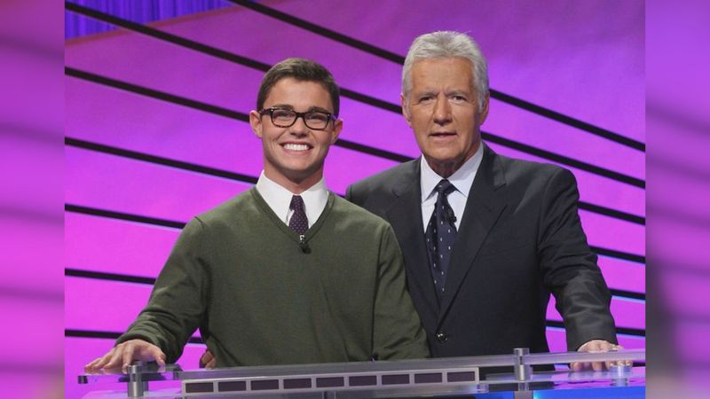 Barrett Block posing with Alex Trebek when he was a contestant on the show.