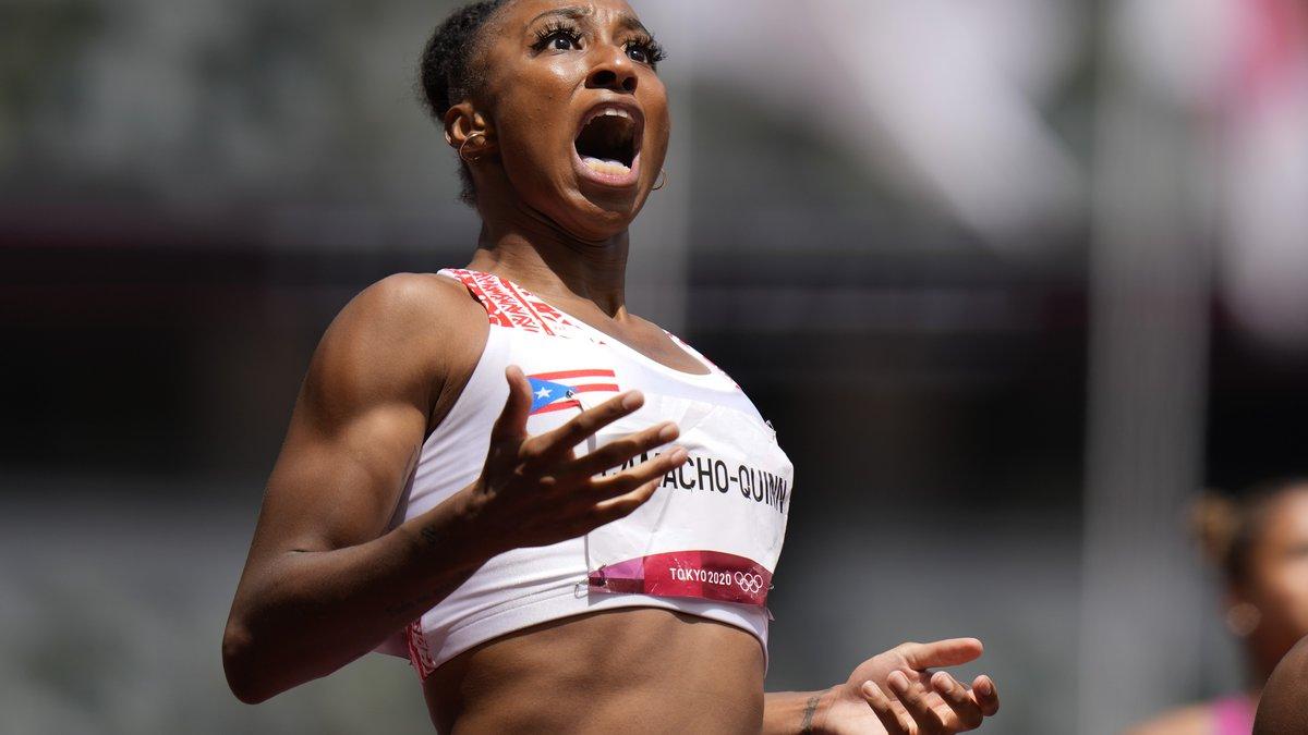 Jasmine Camacho-Quinn, of Puerto Rico, reacts after winning the women's 100-meters hurdles...