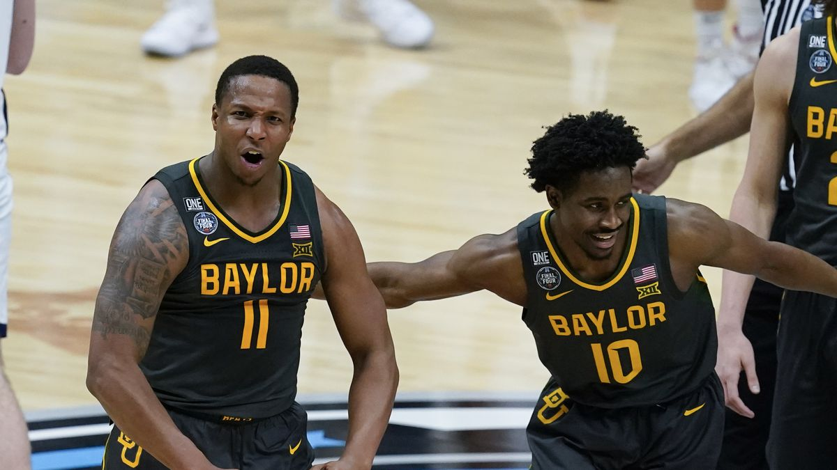 Baylor guard Mark Vital (11) celebrates with teammate guard Adam Flagler (10) during a timeout...