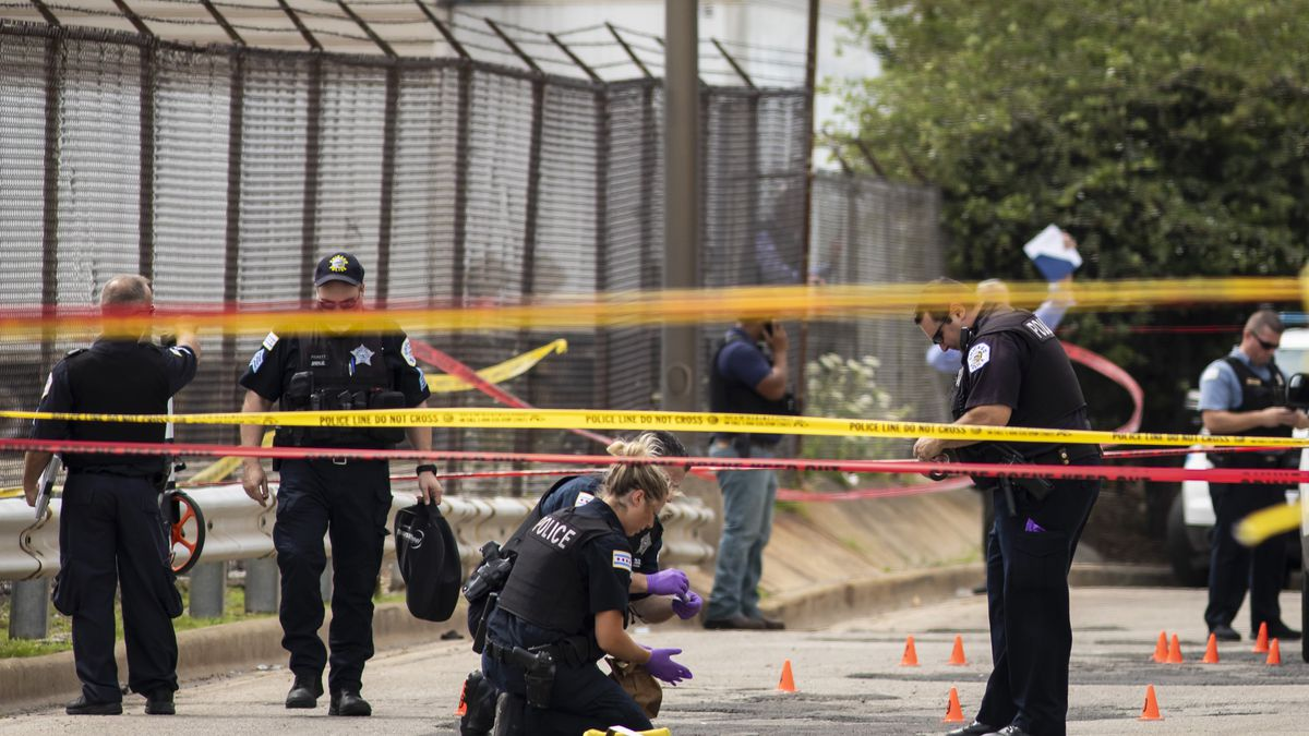 Chicago Police investigate at the 25th District station on the Northwest Side, after several officers were shot outside the station, Thursday, July 30, 2020. Authorities say a carjacking suspect being led into the Chicago police station shot three officers who returned fire and shot him.