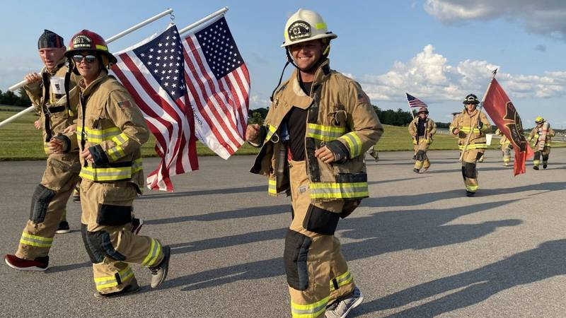 Firefighters run in honor of 911 victims.