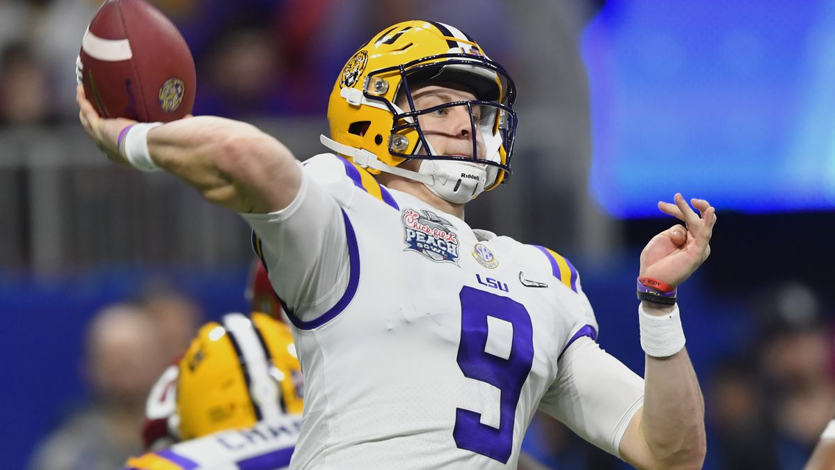 LSU quarterback Joe Burrow (9) works against Oklahoma during the first half of the Peach Bowl NCAA semifinal college football playoff game, Saturday, Dec. 28, 2019, in Atlanta. (AP Photo/John Amis)