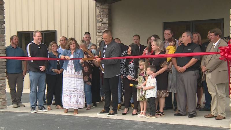 Senior Pastor Jerry Lewis cuts a ribbon to celebrate the Freedom Christian Fellowship Church's...