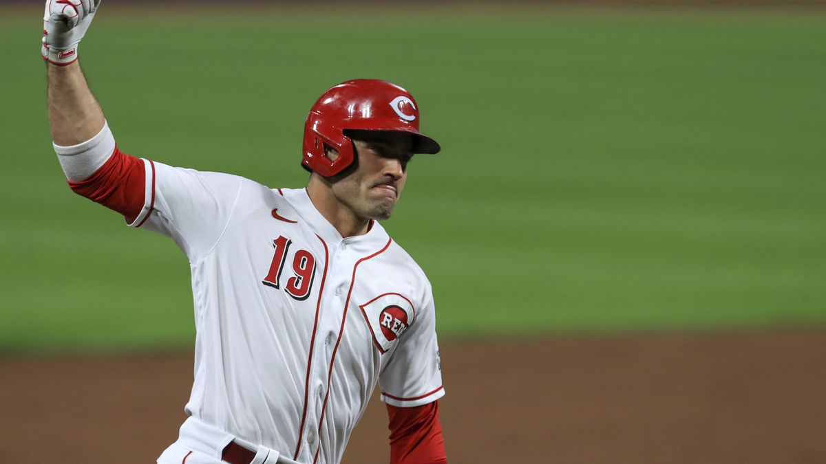 FILE - Cincinnati Reds' Joey Votto reacts as he runs the bases after hitting a solo home run in...